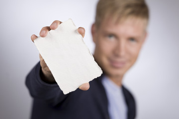 Man presenting empty white card.