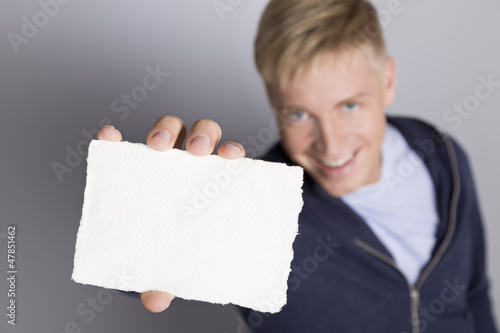Joyful man showing empty white card.