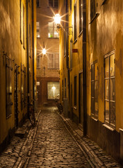 Narrow street in Stockholm Old town at night.