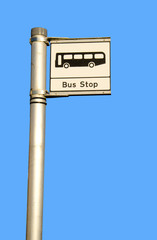 bus stop sign on bright blue sky background