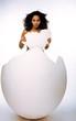 black skined woman in big crashed egg