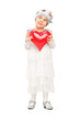 Girl in dress holding a red heart and thinking