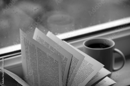 Cup of coffee and book pages- black and white