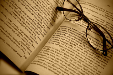 Book pages and glasses with sepia color filter