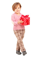 Full length portrait of a smiling child holding a gift