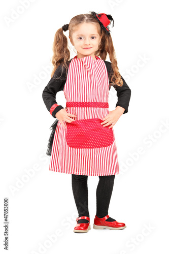 Smiling girl wearing apron and posing