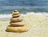 spa stones on sea shore background