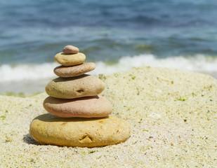 spa stones on sea shore background
