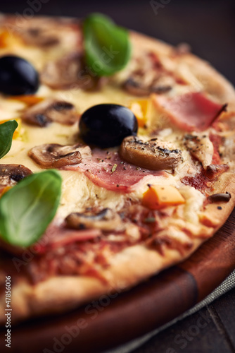Close up of pizza with mushrooms and ham