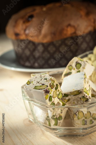 Turrón(torrone) with pistachios and Panettone