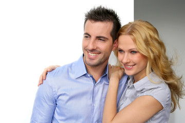 Portrait of cheerful couple looking away