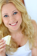Attractive girl holding slice of french cheese