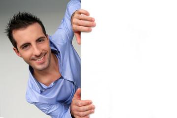 Smart guy holding whiteboard