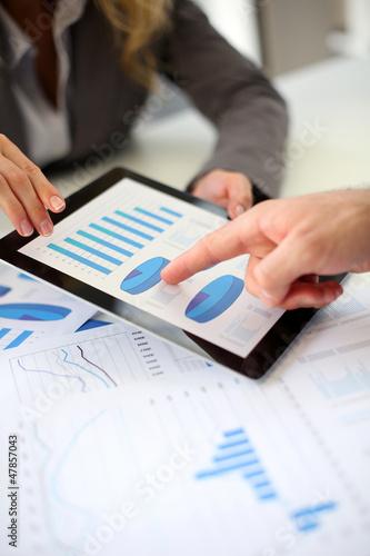 Business plan presentation on digital tablet
