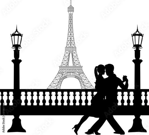 Romantic couple dancing in front of Eiffel tower in Paris