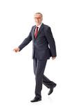 Walking mature business man 4