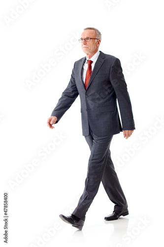 Walking mature business man 3