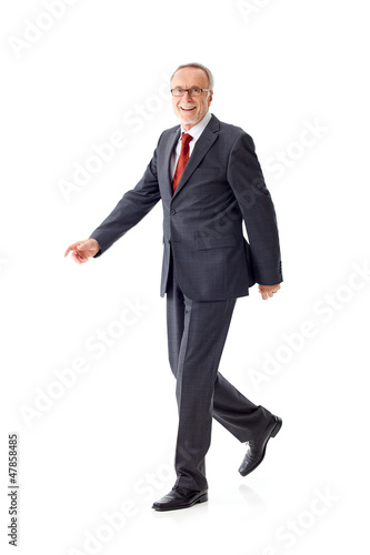 Walking mature business man 4