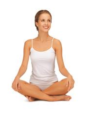woman in undrewear practicing yoga lotus pose