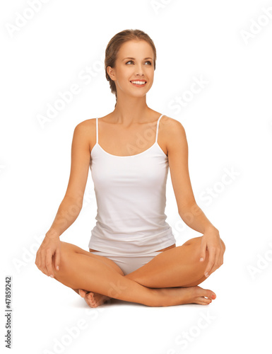 woman in undrewear practicing yoga lotus pose