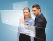 man and woman working with virtual touch screens