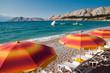 Orange sunshades and deck chairs on Baska beach - Krk - Croatia