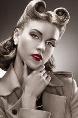 Retro Style. B&W Portrait. Styled Woman with Pin-up Hairdo