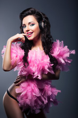 Sexy Desirable Woman in Pink Feathers Dancing - Nightlife