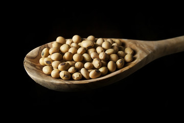 Soya beans on a wooden spoon