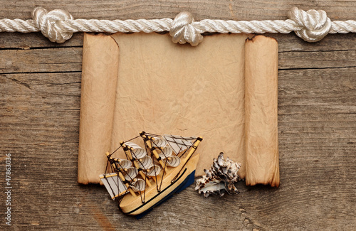 rope and model classic boat on wood background