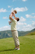 Father and child on a hill