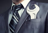 Businessman with spanner