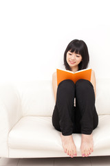 attractive asian woman reading a book