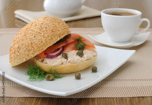 Salmon sandwich and a cup of coffee