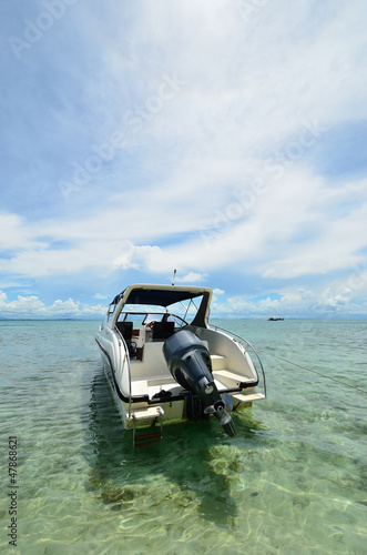Speed boat Beach talu Island in the sunshine day, Thailand