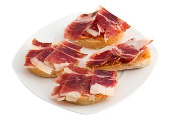 Spanish tapas, ham and tomato