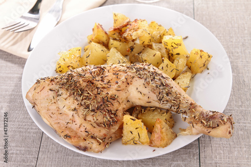 grilled chicken leg and potatoes