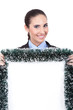 smiling businesswoman holding christmas billboard