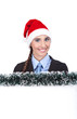 businesswoman with santa hat holding banner