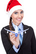santa businesswoman  holding  plane