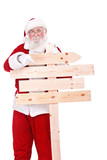 Santa pointing in wooden sing