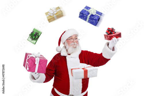 Santa Claus throwing and playing with presents