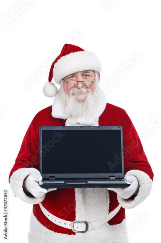 Santa Claus holding modern laptop, copy space, isolated on white