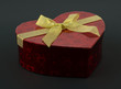 Heart red present box with golden ribbon isolated on black