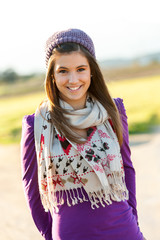 Portrait of cute teen girl with scarf and beanie.
