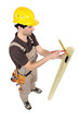 Carpenter using a angle iron.