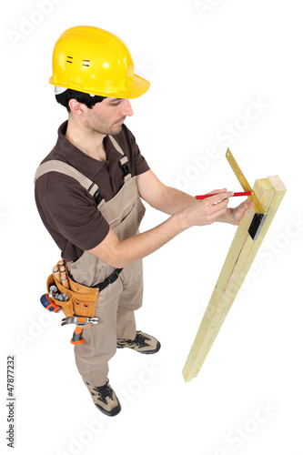 Carpenter using a angle iron.