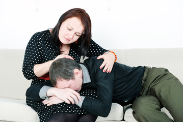Woman comforting her crying man