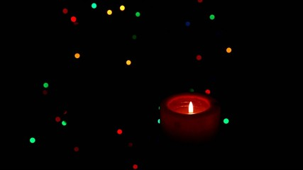 Christmas candle on the background the Christmas tree