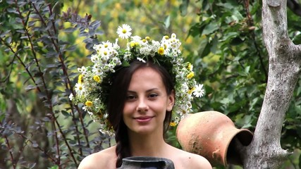 a beautiful girl with a jug,girl in a wreath of flowers,